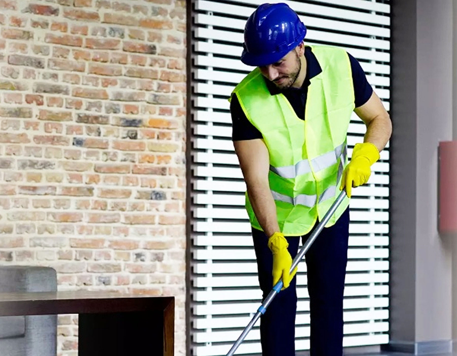 cleaner mopping the floor after builders work