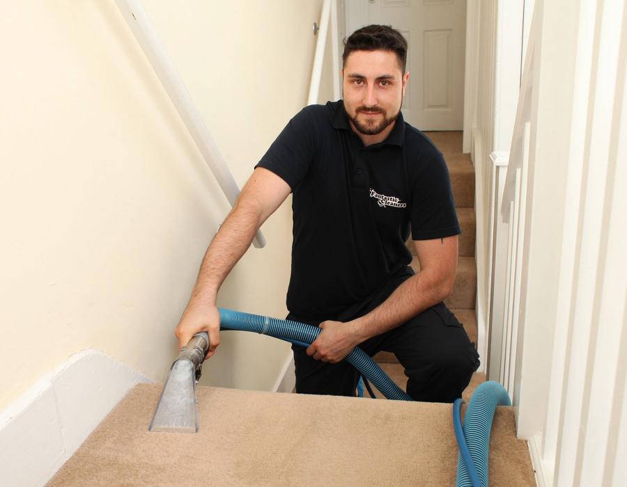 Carpet cleaner vacuuming stairs