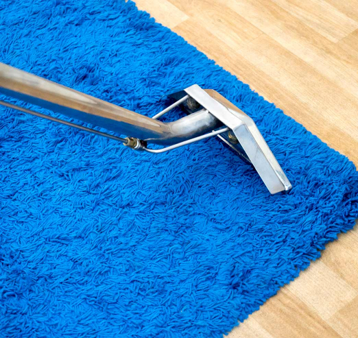 blue carpet being cleaned
