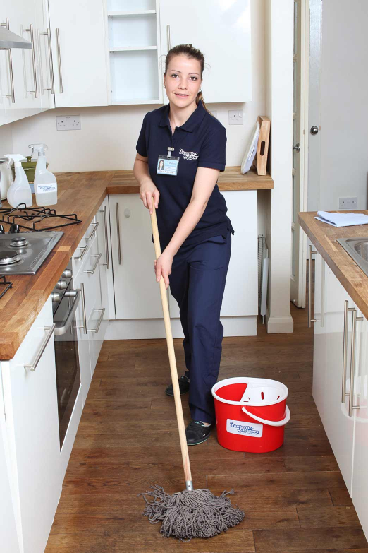 cleaner mopping the floor