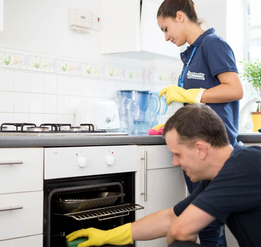 cleaners cleaning a kitchen