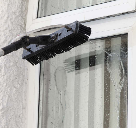 professional window cleaning on the outside with purified water
